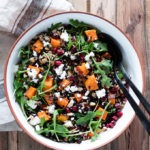 grain salad in white and brown bowl