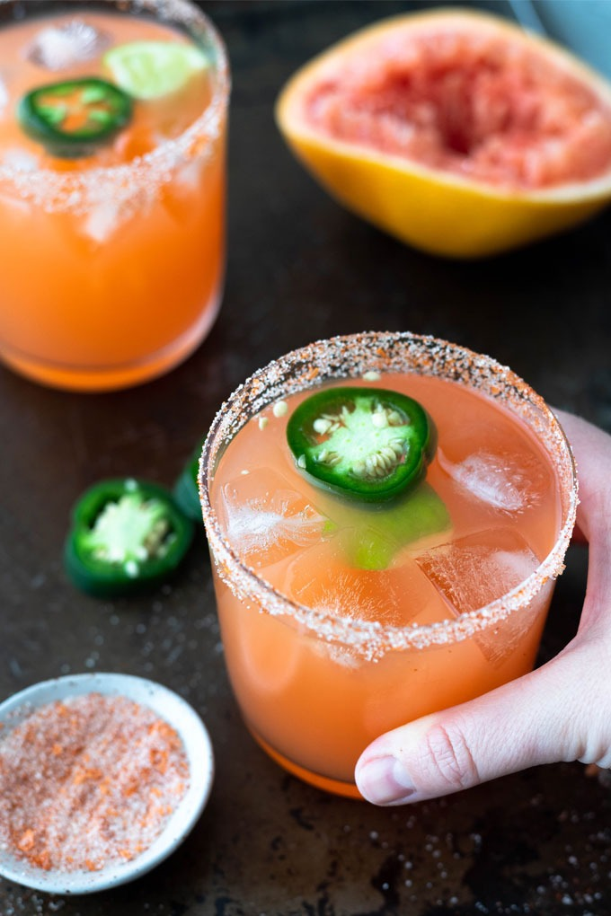 hand reaching out to grab spicy margarita