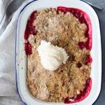 rhubarb crumble in enamel dish with ice cream