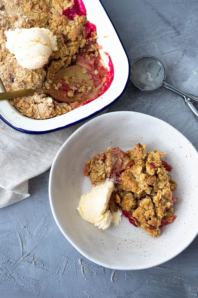 rhubarb crumble in bowl with ice cream