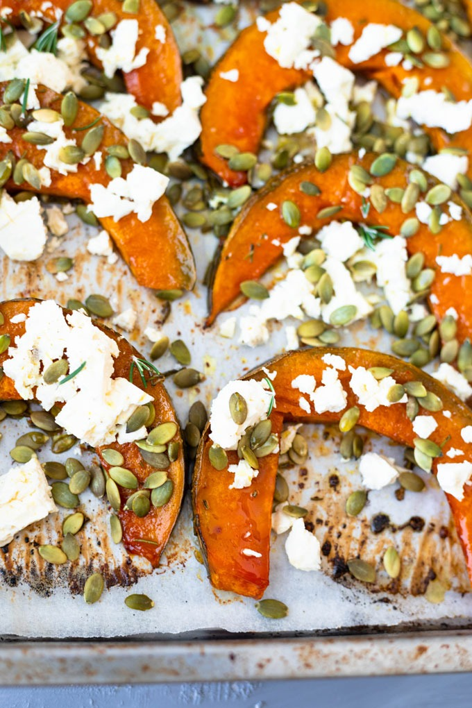 roast pumpkin on baking tray topped with feta and pepitas
