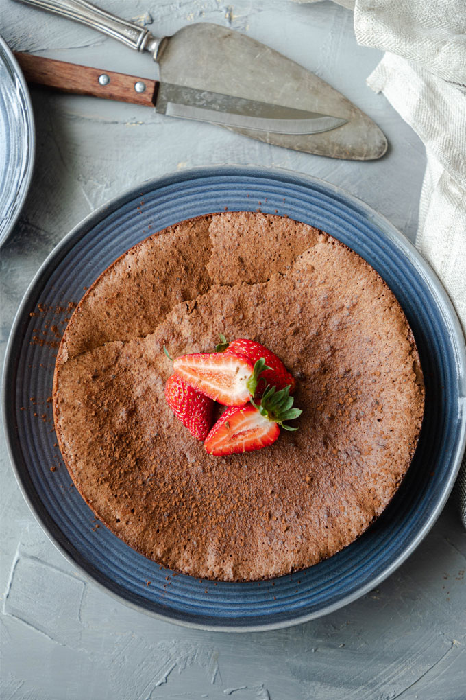 flourless chocolate torte on blue plate