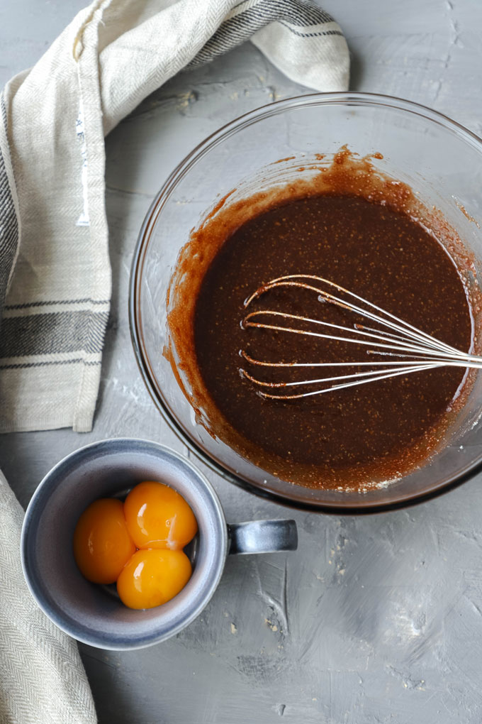 eggs next to chocolate batter for flourless chocolate torte