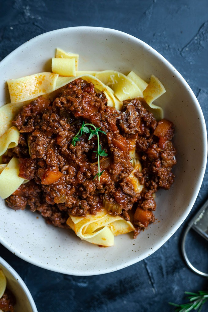 close up lamb ragu in bowl