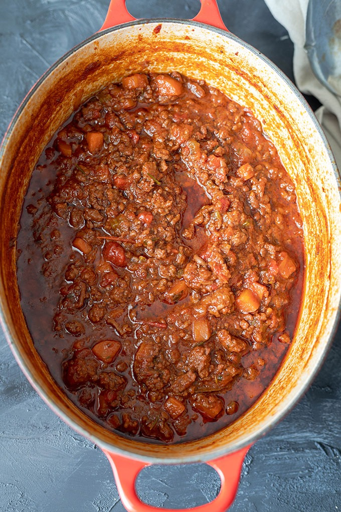 cooked lamb ragu in red dutch oven