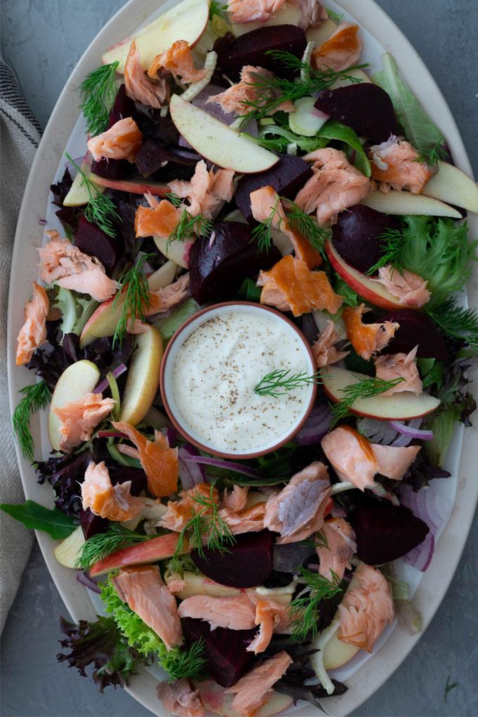 smoked salmon salad on large white platter