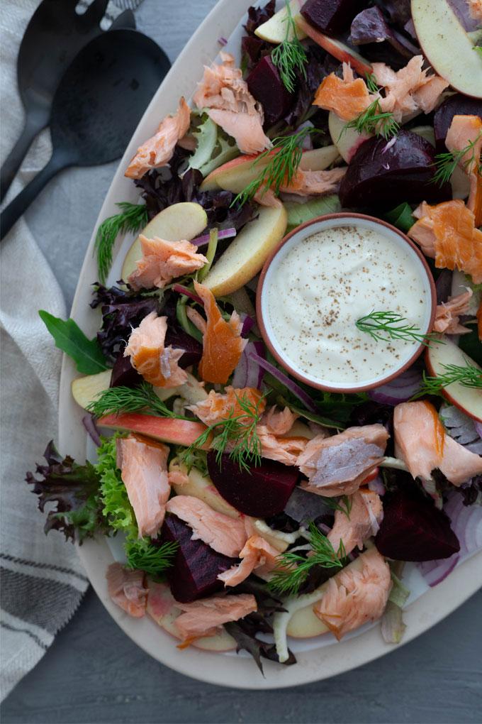 close up smoked salmon salad on large platter