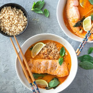 salmon curry in bowl with rice and chopsticks