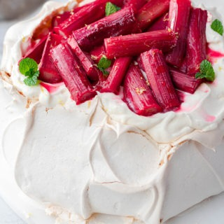 Christmas pavlova with rhubarb on marble board