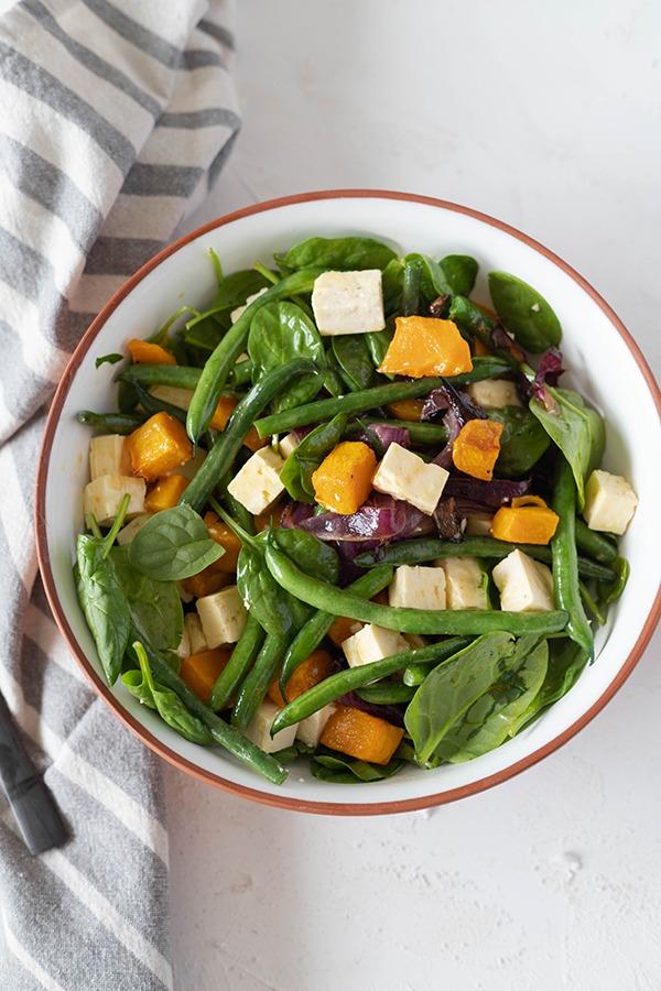 roast pumpkin salad in salad bowl with napkin
