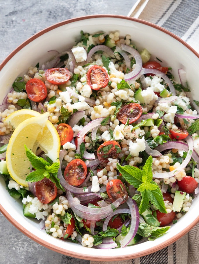 israeli couscous salad in large bowl