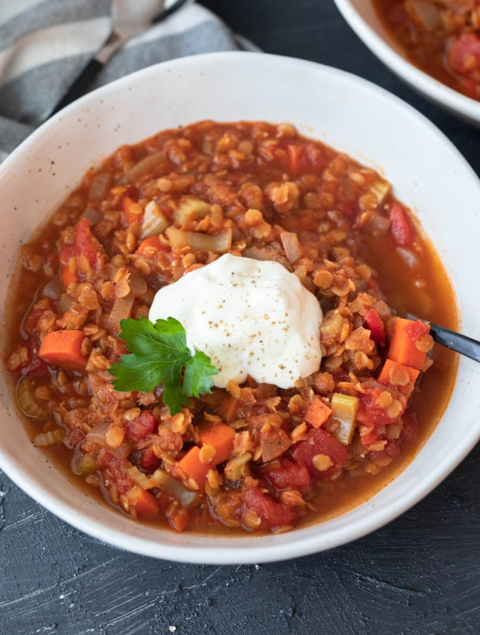 spicy lentil soup in white bowl