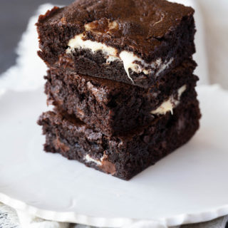 triple chocolate brownies on a white plate