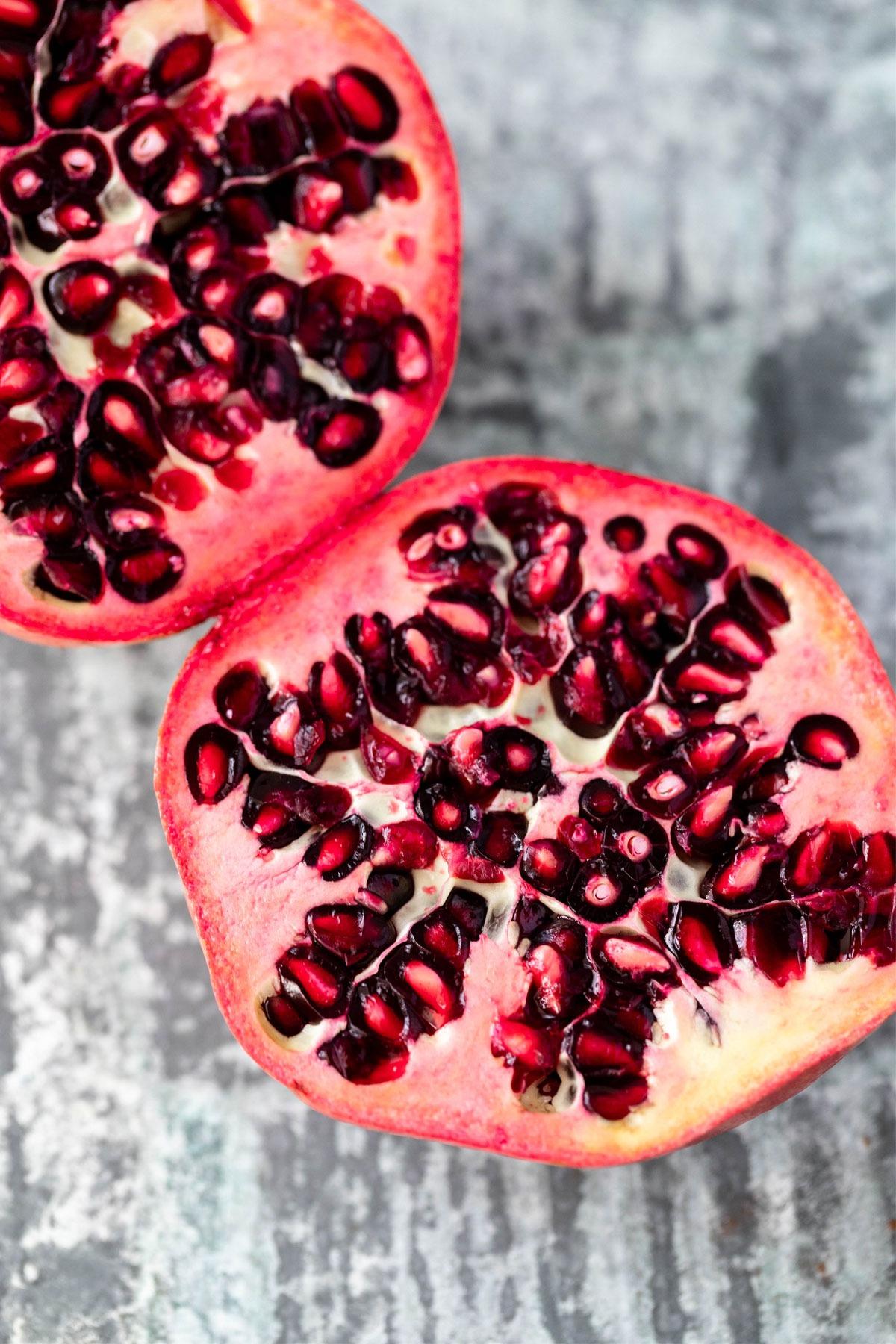 cut open pomegranate on board