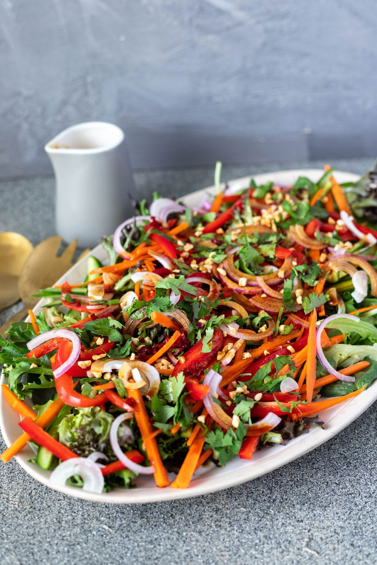 Thai salad on large platter with dressing
